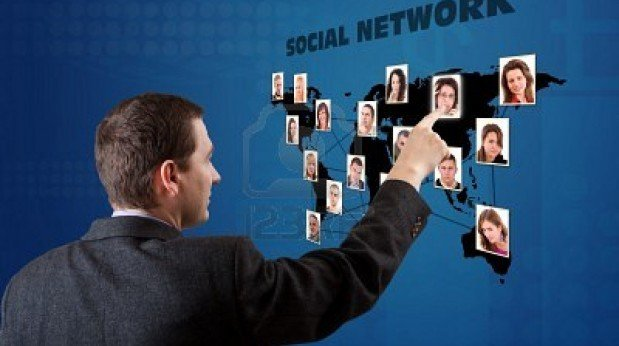 9295503-business-man-pressing-a-social-network-map