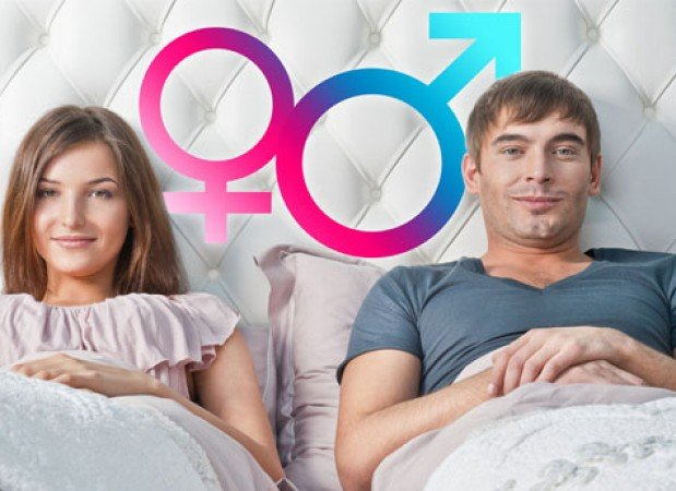 Man-and-woman-in-bed-with-gender-symbols-via-Shutterstock